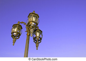 Lamp post under the blue sky