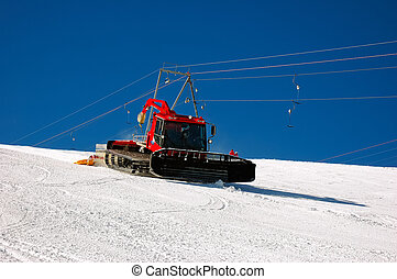 snowplow working on a ski slope Winter ski resort, Zermatt,...