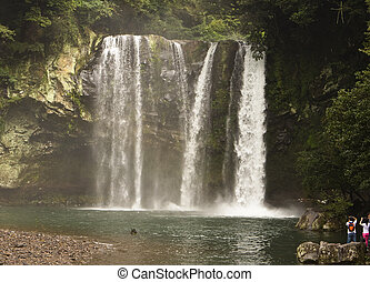Waterfall In Korea - Cheonjiyeon Falls on Jeju Island is one...