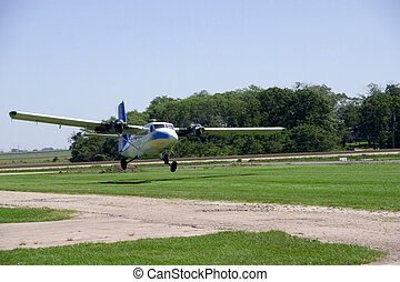 Landing Plane - This is a medium sized twin engine propeller...