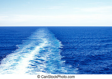 Blue ocean water wake - The wake of a cruise ship shown in...