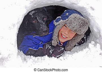 A Boy and His Dog - A fun picture of a boy and his black lab...