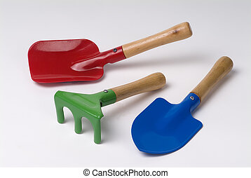 Three kids garden tools - red shovel, green rake and blue...