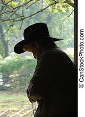 Silhouette of a cowboy - Cowboy standing in the doorway