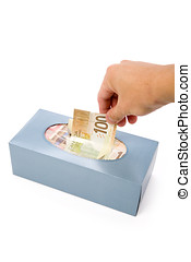 canadian dollars in a tissue box, business concept, wasting...