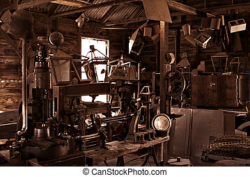 old workshop - an old busy and cluttered workshop in russet