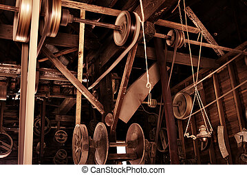 old factory - ropes, pulleys and machinery in an old factory...