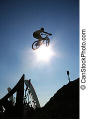 Air - A mountain biker flies through the air in Norway.