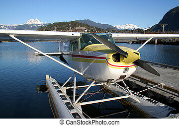 Fly Away With Me - A floatplane tied to a dock in Squamish,...