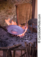 Fire on copper - still life of a copper pan melting on a...
