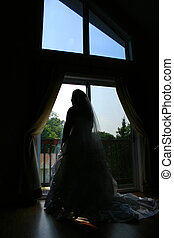 bride silhouette - A bride eagerly pondering her wedding day...