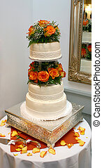 wedding cake - A three-tiered wedding cake with fondant...