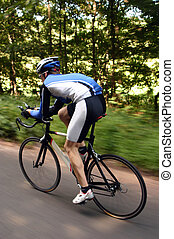 quick cyclist - An action shot of a cyclist on a road bike...