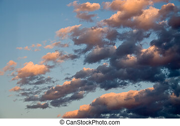 Morning Clouds - Blue sky with early morning clouds tinted...