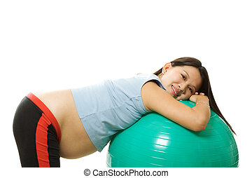 Pregnant woman exercising - A pregnant woman doing a...