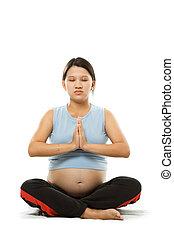 Pregnant woman - A shot of a pregnant woman meditating