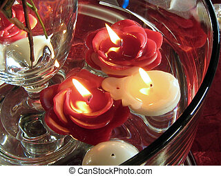 Floating Flower Candles - A shot of three lit flower candles...