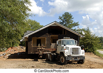 House Movers - A house being relocated by house movers