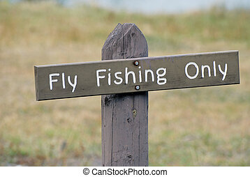 Fly Fishing Only Sign - Wooden sign on post with the words,...