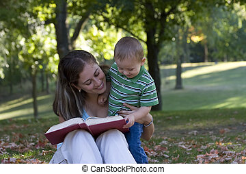 Mother and child - Mother reading to child in the park