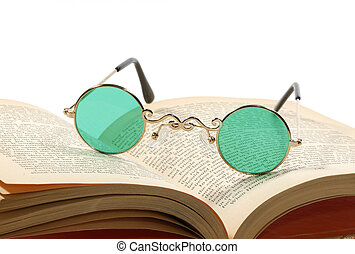 Reading - Photo of Bifocals on a Book - Reading Concept