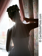 Silhouette - The beautiful bride prepares for wedding...
