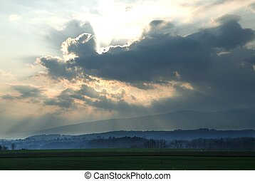 dramatic sky and sunlight - Sunlight through clouds