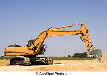 Excavator - Orange excavator at construction site