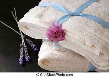 Heaped Towels - Heaped towels with blue ribbon and fresh...