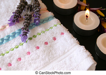 Close up Candles - Close up of face towel, lavender and...