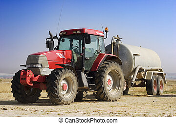 Red tractor with a water tank