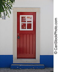 A red door in Portugal - Ared door in Porto Covo, western...