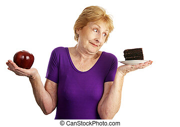 Simply Irresistable - Fit senior woman making food choices....