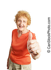 Red Haired Senior Thumbsup - A happy red haired senior lady...