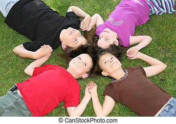 Friends Until The End - Four Children Smiling While Lying in...