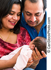 Joy of parenthood - A young couple with their baby