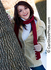 Winter blast - A playful young woman outdoors in the...