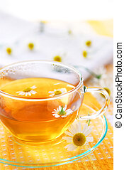 Chamomile tea - A teacup with soothing herbal camomile tea