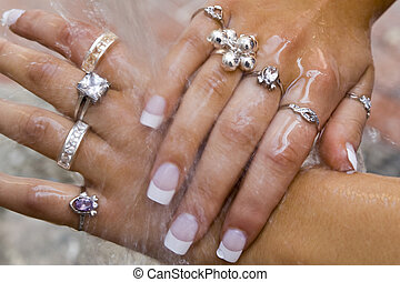 Bling! - Beautifully manicured women\\\'s hands covered in...