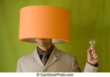 Businessman lamp head - a businessman with a lamp in his...