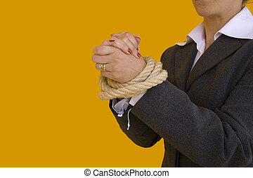 Business crime - a business woman with her hands tied for a...