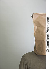 Shy man - Man wearing paper bag on his head to hide from the...