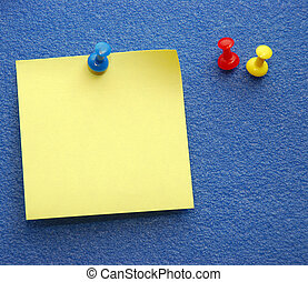 Yellow Notepaper - A yellow notepaper pinned on a blue board...