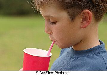 Child drinking through a straw