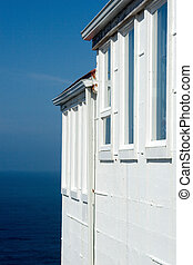 Ocean View - white walls with blue sky and ocean in...