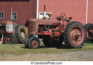 Old red tractors - Two Old red tractors with tires
