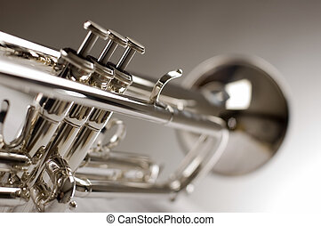 trumpet - Trumpet on musical notes as background close up