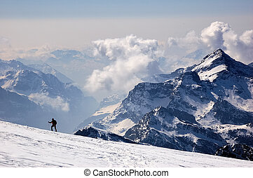 Mountaineer walking on a glacier, West Alps, Swiss