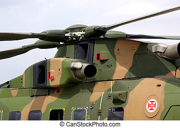 A military helicopter closeup stopped in the hangar.