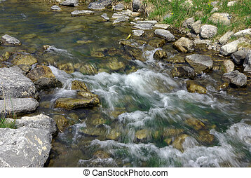 Babbling Brook - A small creek stream with flowing water...